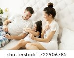 mother  father and a daughter...   Shutterstock . vector #722906785