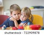 hugged little caucasian kids | Shutterstock . vector #722909878