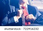 businessman adjusting necktie... | Shutterstock . vector #722916232