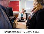 staff checking passport of... | Shutterstock . vector #722935168