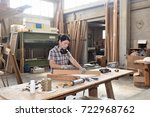 a woman working in a carpentry... | Shutterstock . vector #722968762