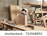 a woman working in a carpentry... | Shutterstock . vector #722968852