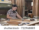 a woman working in a carpentry... | Shutterstock . vector #722968885