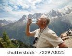 elderly man drinking water from ... | Shutterstock . vector #722970025