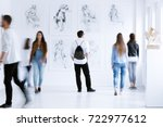 young man with rucksack on back ... | Shutterstock . vector #722977612