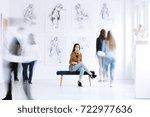 tourist woman sitting on stool...   Shutterstock . vector #722977636