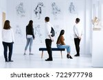Visitors In Art Gallery With...