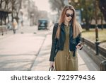 beautiful girl in the city with ... | Shutterstock . vector #722979436