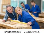 carpenter woman and man with in ... | Shutterstock . vector #723006916