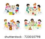 group of children painting on... | Shutterstock .eps vector #723010798
