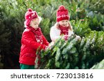 family selecting christmas tree.... | Shutterstock . vector #723013816