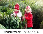 family selecting christmas tree.... | Shutterstock . vector #723014716