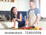 young man cutting vegetables... | Shutterstock . vector #723015556