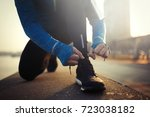 sportsman tying shoelaces after ... | Shutterstock . vector #723038182