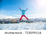 young snowboarder woman jumping ...   Shutterstock . vector #723059116