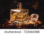 Perfume Bottle On Wooden...
