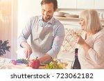 cheerful adult man standing in...   Shutterstock . vector #723062182