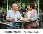 senior couple in love sitting... | Shutterstock . vector #723063466