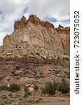 Small photo of Red slick rock canyons and mesa abound in the beautiful landscape of Capitol Reef National Park in Utah