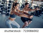 young couple is working out at... | Shutterstock . vector #723086002