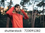 man wearing earphones looking... | Shutterstock . vector #723091282