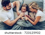 Stock photo top view of happy family is having fun in bedroom enjoying being together parents are tickling 723125932
