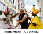 tourist dancing with local ... | Shutterstock . vector #723145582
