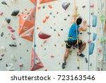 fit asian man rock climbing... | Shutterstock . vector #723163546