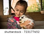 Stock photo rabbit cute little girl holding in her embrace cute rabbit 723177652