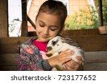 rabbit. cute little girl...   Shutterstock . vector #723177652