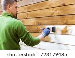 worker painting house exterior... | Shutterstock . vector #723179485