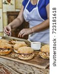 home cooking. a woman is... | Shutterstock . vector #723181618