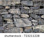 stones in metal wire cage... | Shutterstock . vector #723211228