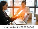 businesspeople working on smart ... | Shutterstock . vector #723224842
