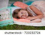 the girl lies in the tent | Shutterstock . vector #723232726