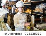 bakery mature employee with...   Shutterstock . vector #723235312
