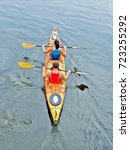 Small photo of Canoeing, canoeing, rowing, boat rental. Active leisure and sports with family on the river.