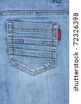 Closeup of back blue jeans pocket with colourful stitches. - stock photo