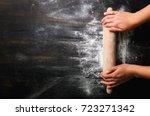 girl hands keep rolling pin... | Shutterstock . vector #723271342