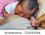 newborn crying while... | Shutterstock . vector #723292036