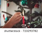 female hand lighting candle on... | Shutterstock . vector #723293782