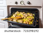 baked potatoes with wings in... | Shutterstock . vector #723298192