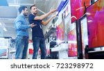 in the electronics store... | Shutterstock . vector #723298972