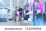 in the electronics store... | Shutterstock . vector #723299056
