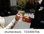 bride and groom clang glasses... | Shutterstock . vector #723300706