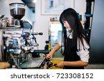 asian women barista smiling and ... | Shutterstock . vector #723308152