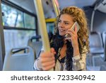 woman inside a bus  on the... | Shutterstock . vector #723340942
