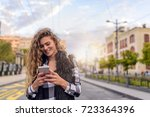 young woman with smart phone... | Shutterstock . vector #723364396