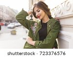 portrait of a dreamy brunette... | Shutterstock . vector #723376576