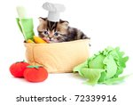 Stock photo smiling cook kitten with toy vegetables isolated 72339916
